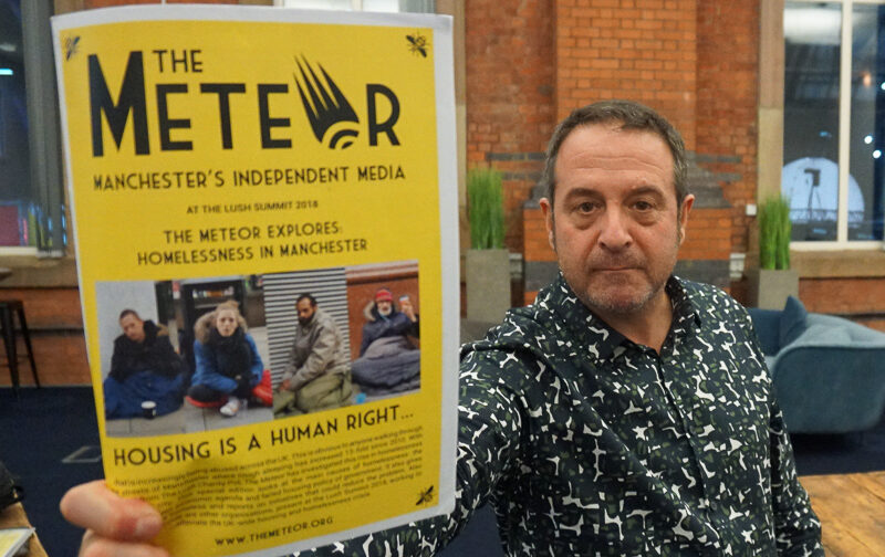 mark thomas holds an edition of the meteor explores: homelessness