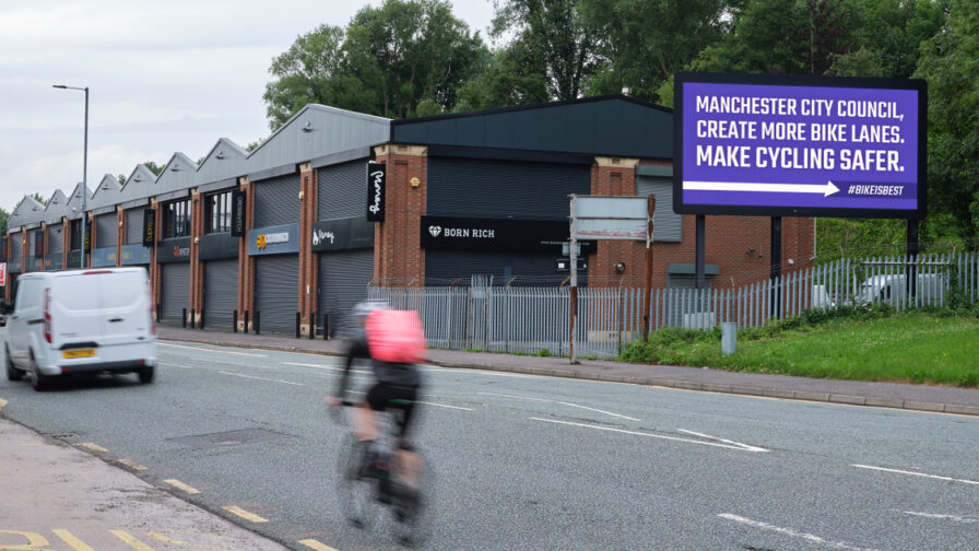 Pro-cycling billboard in Manchester