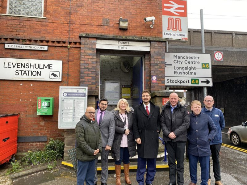 Afzal Khan (fourth from left) and colleagues outside Levenshulme Station.