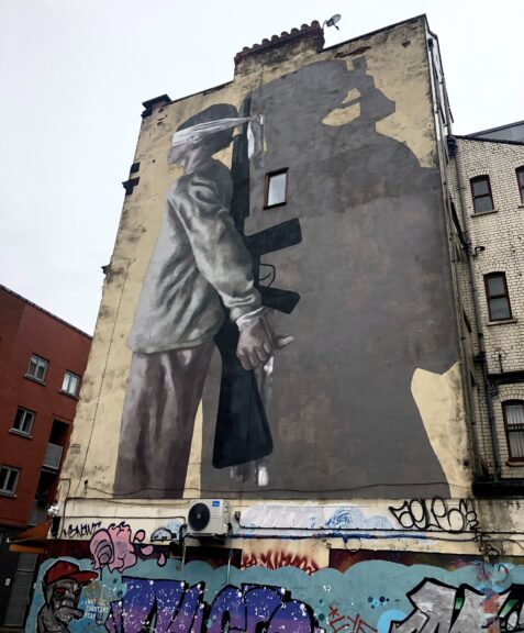steet art in Manchester in article on hostile environment effect on migrants