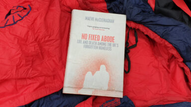 The book - No Fixed Abode: life and death amongst the UK's forgotten homeless - on a sleeping bag