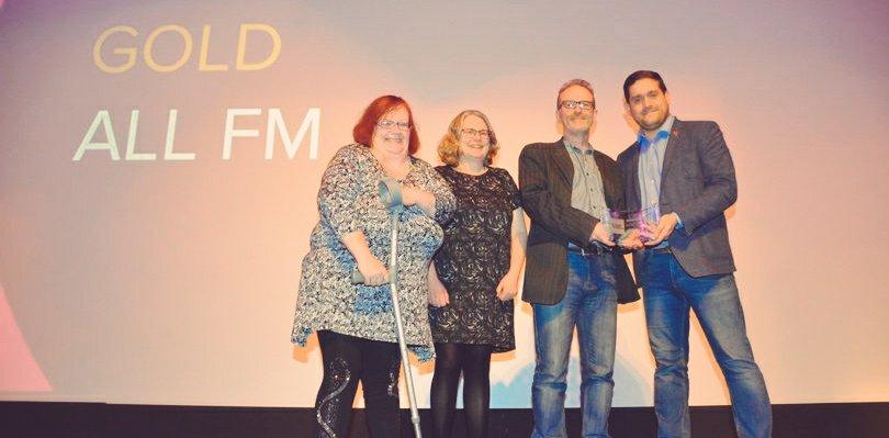 Community radio station ALL FM winninig award on stage