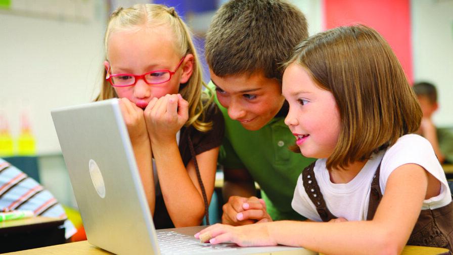 Digital Divide - three children on a laptop computer