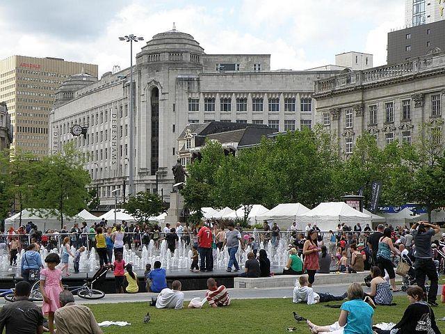 People enjoying Piccadilly Gardens.
