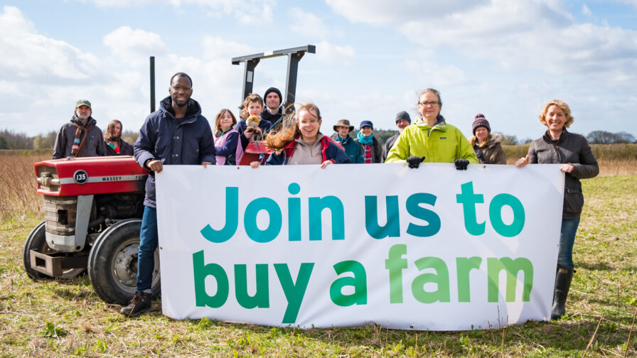 KIndling Farm supporterts with banner saying 'join us to buy a farm'