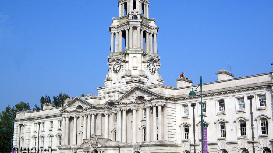 Image of stockport town hall in article about home care deaths.