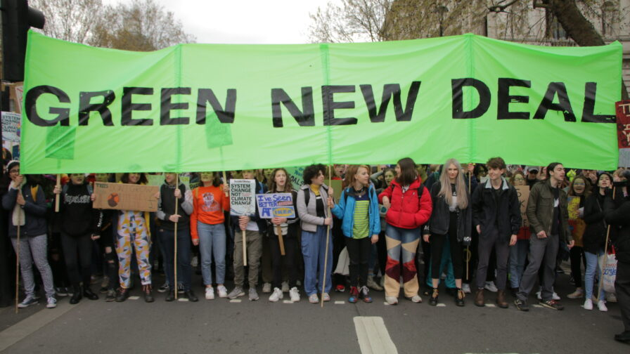 Green New Deal campaigners holding banner
