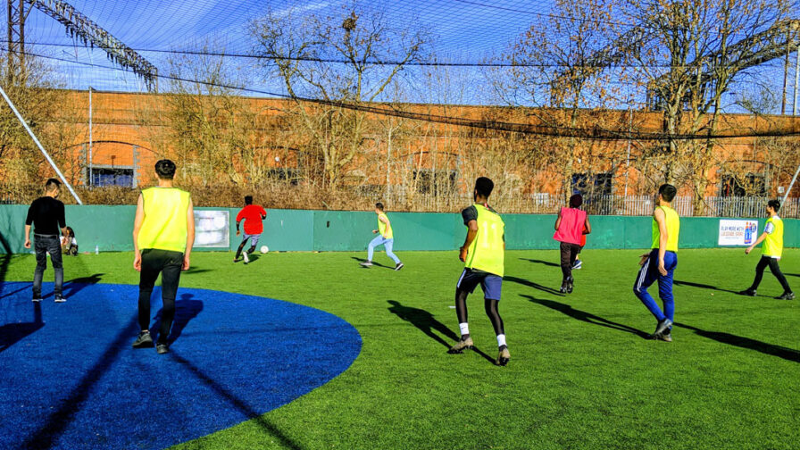asylum seekers playing football