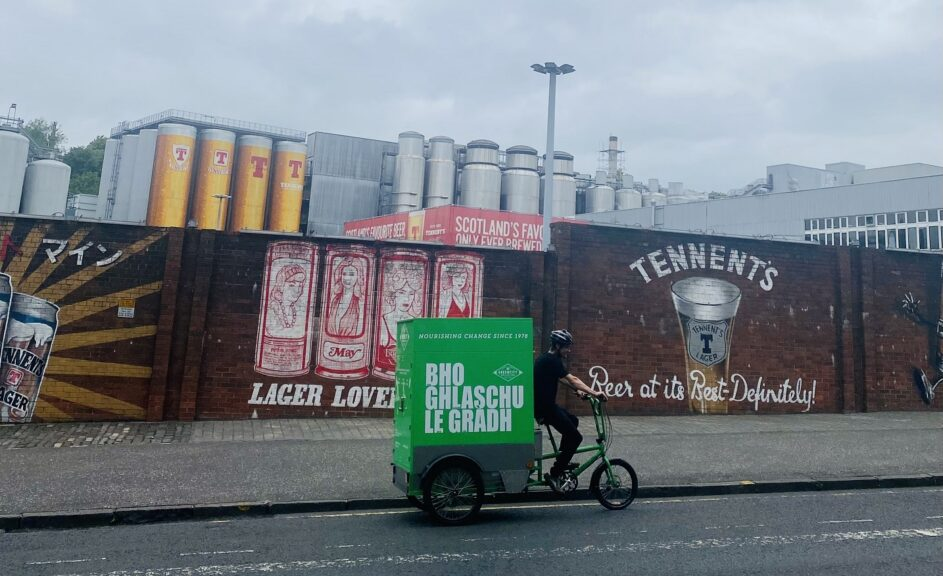 Chorlton Bike Deliveries bike cycling past brewery. Sustainable business in Manchester.