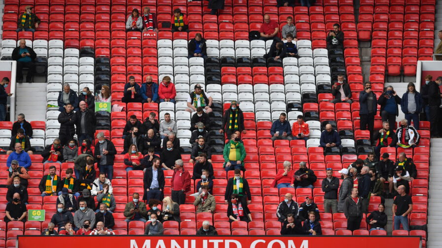 Manchester United fans in stands at Old Trafford