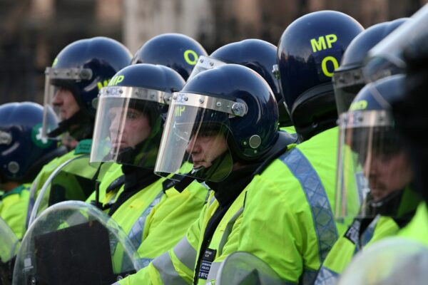 Policing of pandemic disproportionately affected people of colour, report says