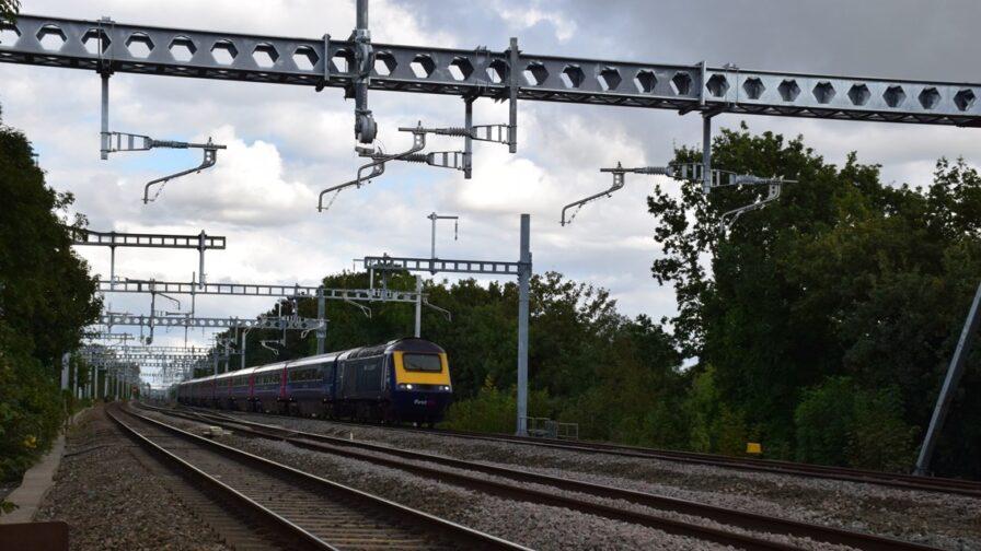 Train travelling along a rail line that has undergone electrification